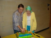 Olin Meadows & Joan Baker cut the Opening Night cake. Photo by Jeff Knoll.
